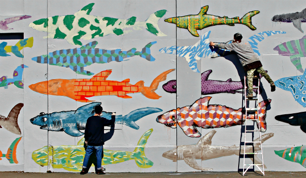 FIN END OF THE WEDGE: BMD's mural in central Wellington highlights the practice of shark-finning, which remains legal here, despite being banned in nearly 100 countries.