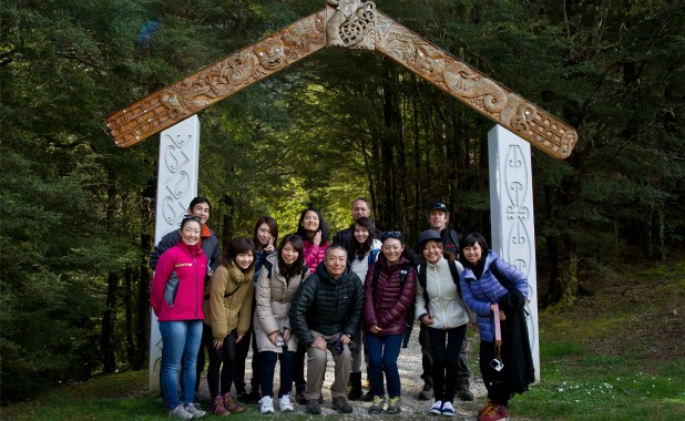 CONNECTING: Japanese students from Tokyo's Seisen University with their professor, Tatsuya Yamamoto, centre front, iwi representative Mike Elkington, centre rear, and Charlie Martin, of Whenua Iti Outdoors, right, at the entrance to the Riwaka Resurgence.