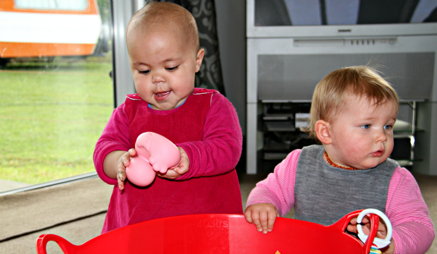 ACTION STATIONS: Gore baby Elliott Gulliver, left, and buddy Ruby Tremaine are firm friends after Ruby's Mum Vanessa helped fundraise for Elliott by making a cookbook.