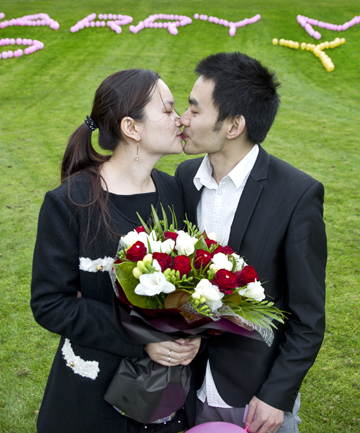 YOUNG LOVE: Feng Fe pops the question to his girlfriend Yi Wei at Massey University.