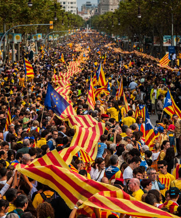 Demonstrators march during the National Day of Catalonia public holiday as they prepare to link up in what became a 400km long human chain.