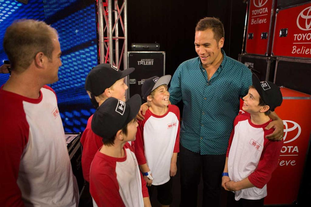 Host Tamati Coffey hangs with young talents from the Troublemakers Dance Crew.
