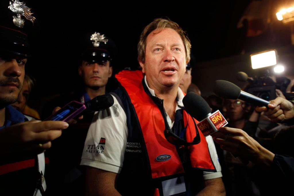 The head of the parbuckling operation Nick Sloane talks with reporters after the Costa Concordia was righted.