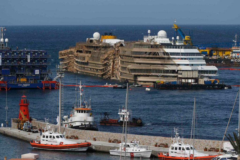 Giglio residents woke Tuesday to find the Costa Concordia righted after a 19 hour parbuckling operation.