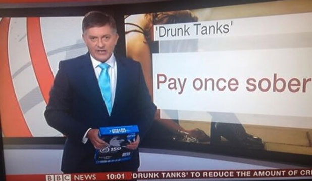 BBC News presenter Simon McCoy thinks he's holding his iPad - it's actually a stack of paper.