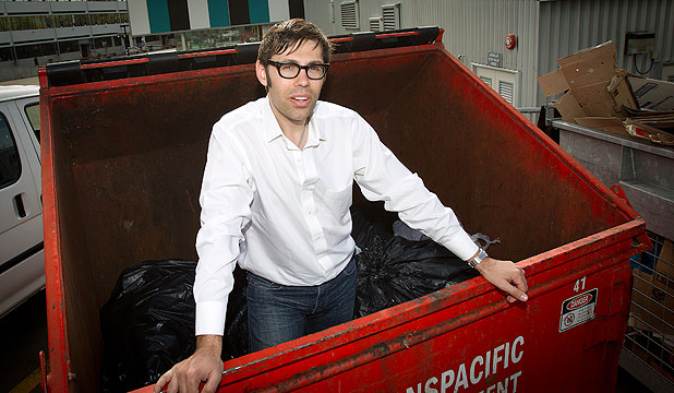TRASH TALK: Dr David Giles stands in a dumpster – a situation familiar to him. As part of his doctorate study into the economics of food consumption, he joined the dumpster-diving culture in Seattle.