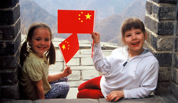 FLYING THE FLAG: Kids are welcome at the Great Wall of China.