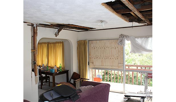 STORM STRIKES: The force of the lightning bolt was enough to shatter a sliding glass door, crack the gib walls and blow the power sockets across the rooms of the Mokoia Rd rental property.
