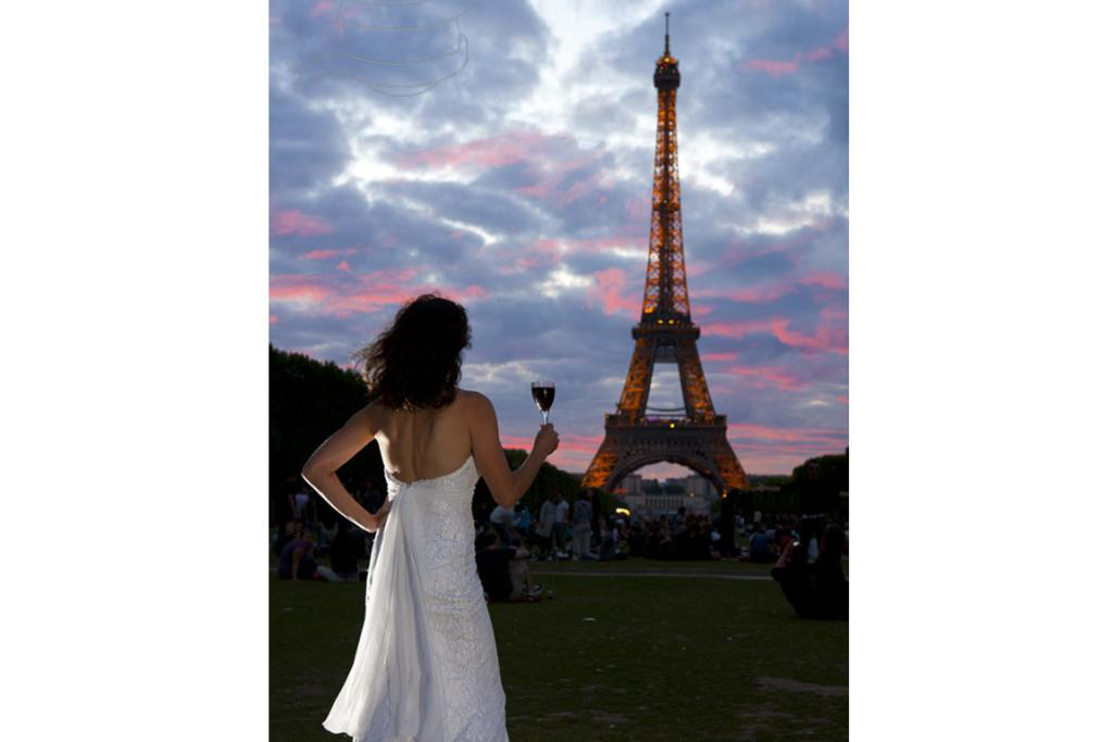 Jennifer toasts the Eiffel tower in her dress.