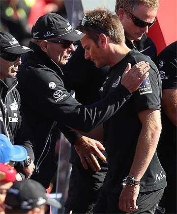 SO CLOSE, SO FAR: Dean Barker is consoled by Team NZ boss Grant Dalton after losing the final America's Cup race to Oracle.