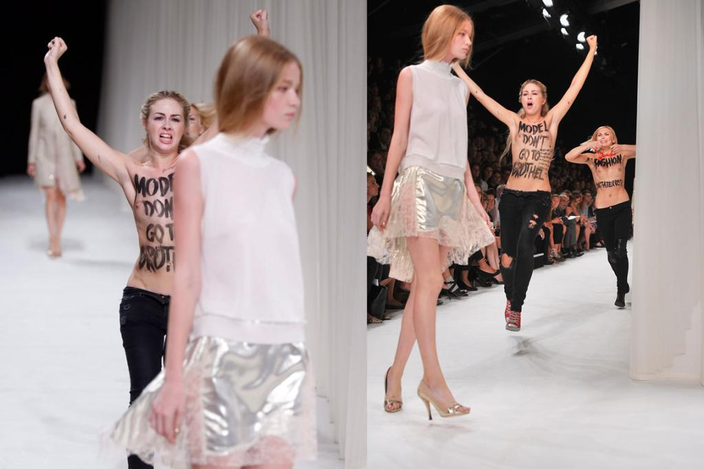 The Nina Ricci catwalk models appeared unperturbed by the FEMEN protest against the industry (WARNING - GALLERY CONTAINS GRAPHIC CONTENT).