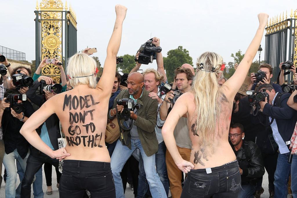 The FEMEN protesters made their point both inside and outside of the catwalk venue (WARNING - GALLERY CONTAINS GRAPHIC CONTENT).