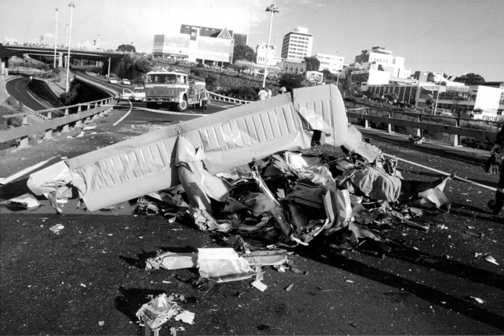 26 November 1993 air accident police helicopter and Piper aeroplane collision over Auckland. Debris landed on motorway at Spaghetti Junction. Four people died.