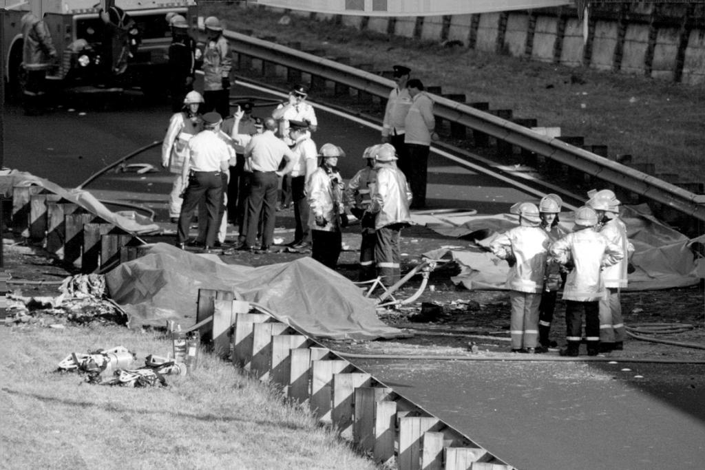 Police helicopter and Piper aeroplane collision over Auckland on 26 November 1993 . Debris landed on motorway at Spaghetti Junction. Four people died.