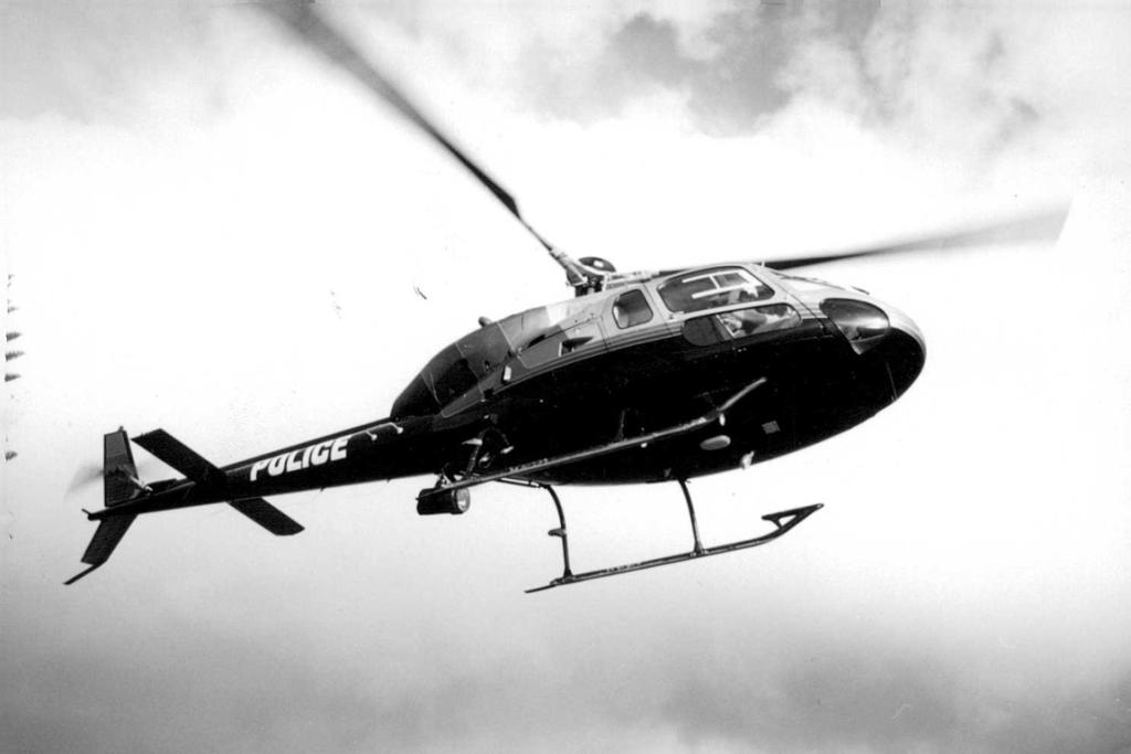 Police Eagle helicopter flying circa 1990. It crashed in a mid-air collision with a police Piper airplane on 26 November 1993 over Auckland with debris falling onto the motorway at Spaghetti Junction.