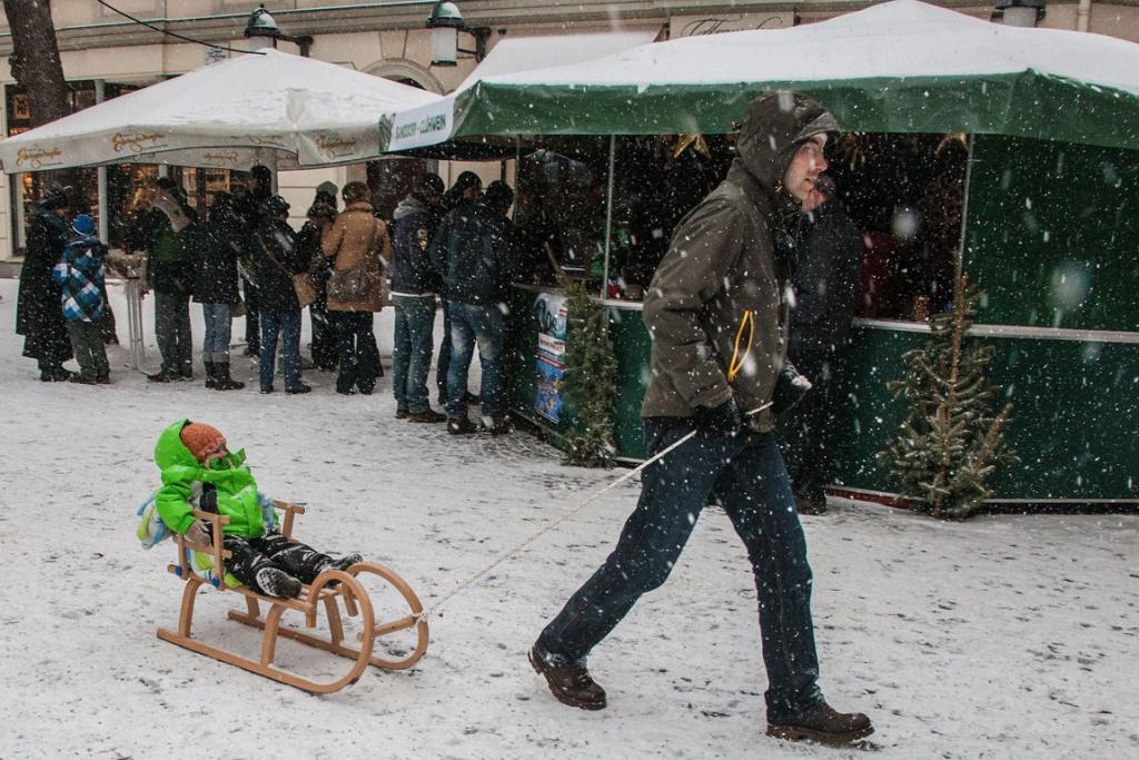 Snow falls on Weimar's Christmas Market in Germany.