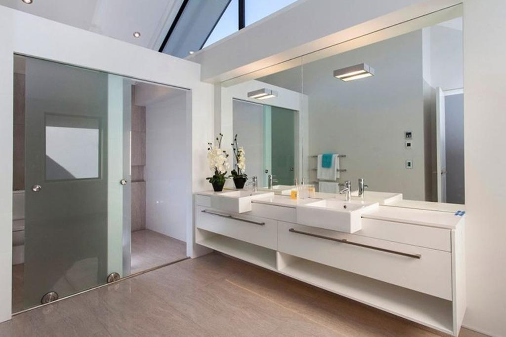 MERIVALE, CHRISTCHURCH: The main bathroom is a bright, airy space thanks to high windows and neutral surfaces. Take a squiz at that shower: pure decadence.