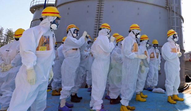Fukushima workers wear protective gear at all times.