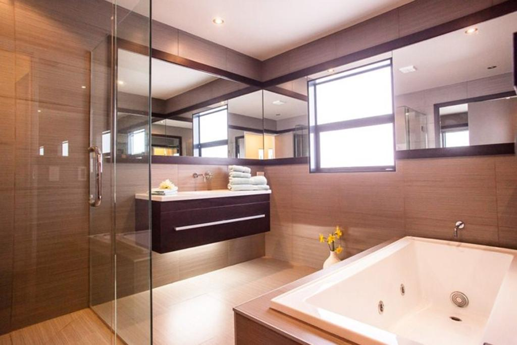 """PALMERSTON NORTH: The main bathroom is a lesson in minimalist decoration (or lack thereof). The dominance of straight lines creates a sharp, yet stunning, aesthetic. <a href=""""http://www.trademe.co.nz/property/residential-property-for-sale/auction-640838135.htm"""" target=""""_blank"""">Check it out.</a>"""