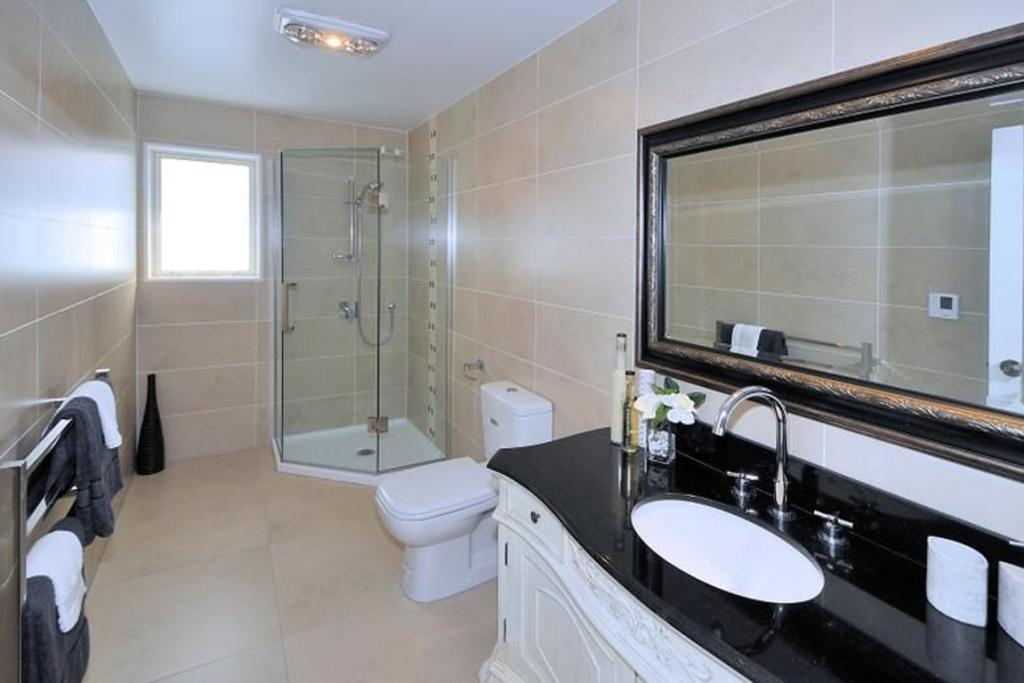 ALBANY, AUCKLAND: Every photo of ths home appears to be beautiful, but a standout has to be the main bathroom.  The show-stopping monochromatic colour scheme is stylish, without being too fussy - something that every bathroom should be.