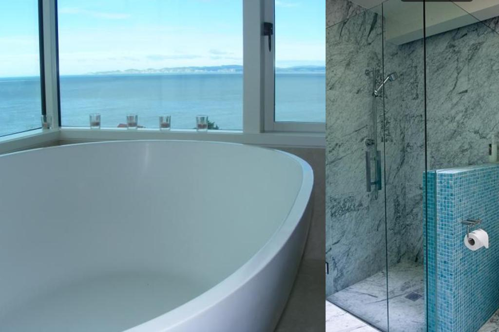 """BLUFF HILL, NAPIER: Each of the three bedrooms comes complete with an adjoining ensuite making it suitable for guests or bigger families. My pick of the bunch has to be this wonderfully large bath placed in just the right position for a spectacular view over the ocean. Some candles, a dash of bubble bath and a glass of white and voila - the perfect relaxing evening. <a href=""""http://www.trademe.co.nz/property/residential-property-for-sale/auction-643103672.htm"""" target=""""_blank"""">Check it out.</a>"""
