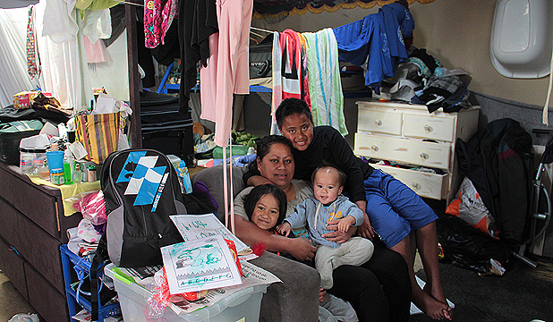 OVERCROWDED: Fonima Crichton with three of her four children, from left: Essie, 5, Kris, 9 months, and William, 11, live in a family friend's garage.