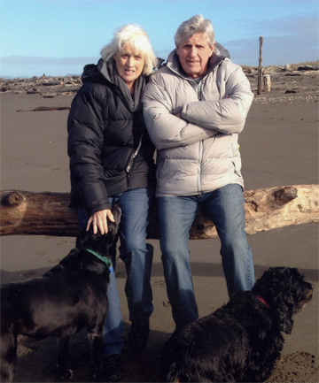 HAVE DOGS: Murray and Pam Ball with their dogs Maggie and Jackson in 2012.