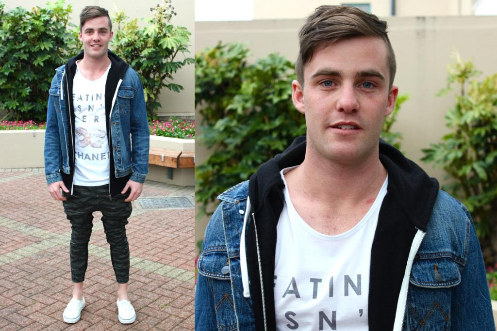 Ben, photographed in Albion Pl, Dunedin wears a Moodie Tuesday T-shirt, Wrangler jacket, Thing Thing pants and Vans shoes.