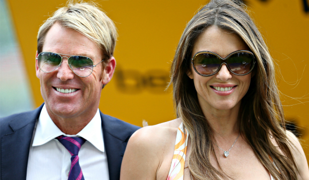 "FIGHTING FOR IT:Shane Warne is reportedly promising Liz Hurley ""the world"" if she takes him back."