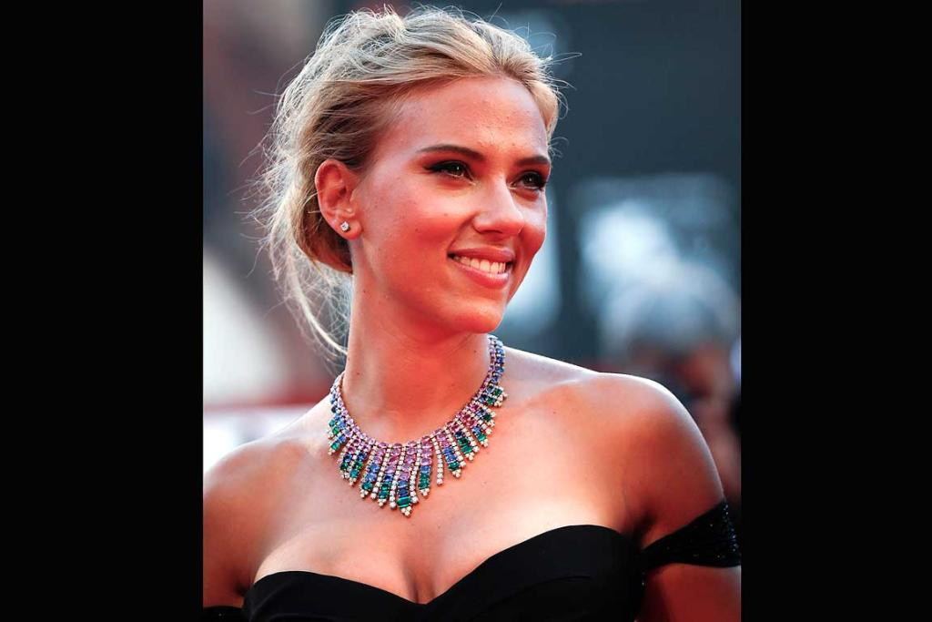 Scarlett Johansson smiles on the red carpet at the Venice Film Festival.