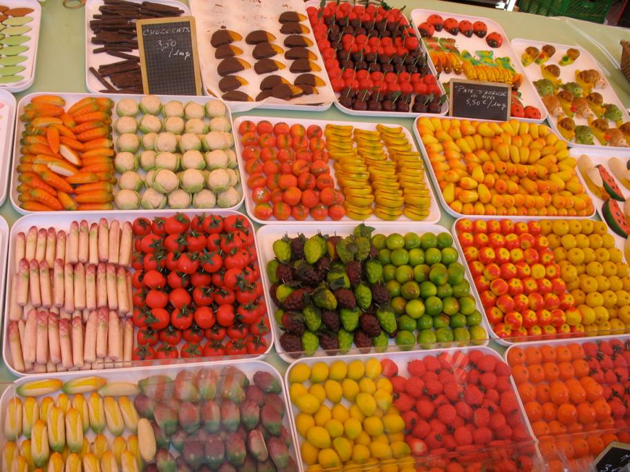 Almond paste can be shaped into many forms; from bananas to asparagus, or carrots to grapes, as seen here at a market in Nice on the French Riviera.