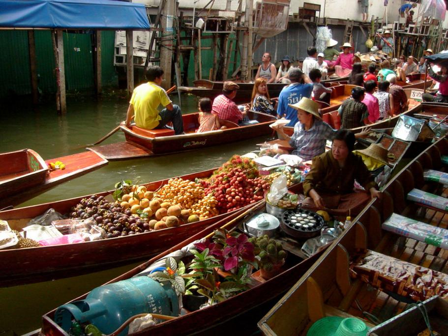 It was all smiles at Bangkok's floating markets where tropical fruit and vegetables are in abundance.