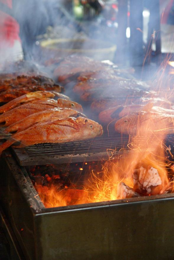 Fish barbecue tastes as good as it sounds and looks at the night markets at Ho Chi Minh City.