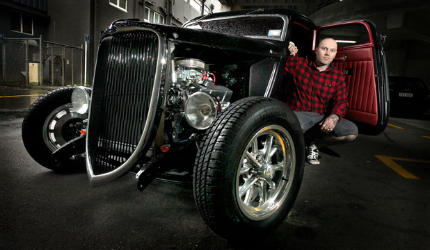 HIGHWAY TO HEAVEN: Hot rods will take centrestage at this year's tattoo festival and, ahead of the event, organiser Brent Taylor checks out a custom-built 1934 Ford coupe, owned by Inglewood woman Delilah Schimanski.