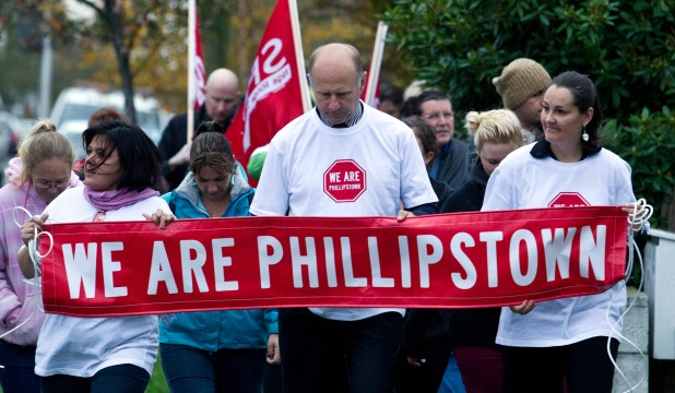 TAKING A STAND: Phillipstown School principal Tony Simpson leads a protest against closure.