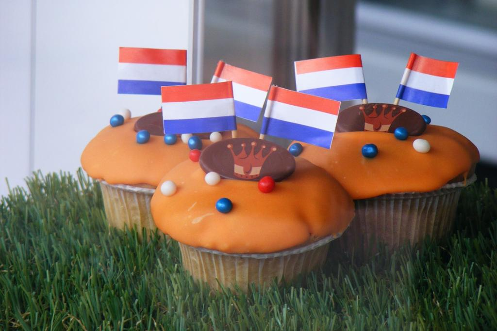 Delicious-looking decorated cupcakes in a shop window in Utrecht, the Netherlands, in celebration of the Dutch queen's very last Queen's Day.