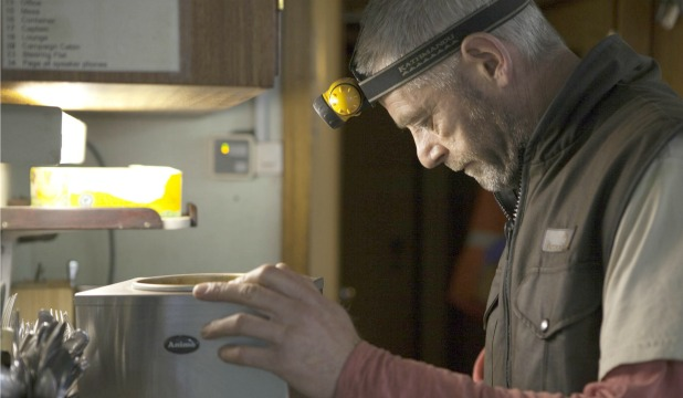 DOWN TO BUSINESS: David Haussmann at work as an electrician on-board the MY Arctic Sunrise.