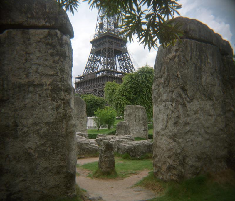 Looking through Stone Henge at the Window of the World, you can see the Eiffel Tower.