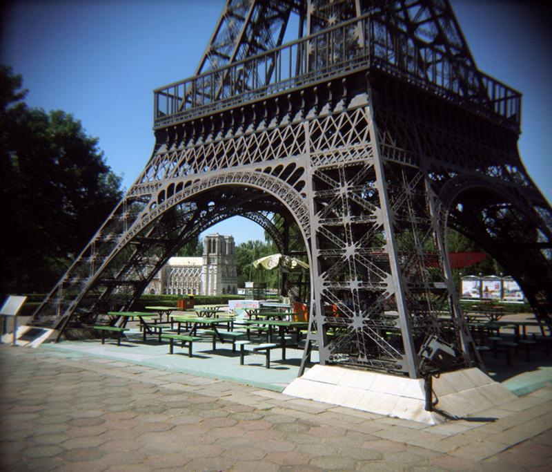 Meanwhile at Beijing's World Park, you can grab a seat and eat beneath the famous French monument.