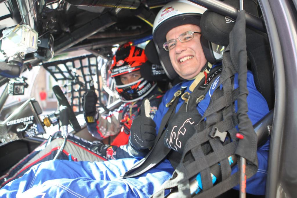 In the fast lane, Len Brown got to take a ride in a V8 Supercar with racing driver Jamie Whincup.