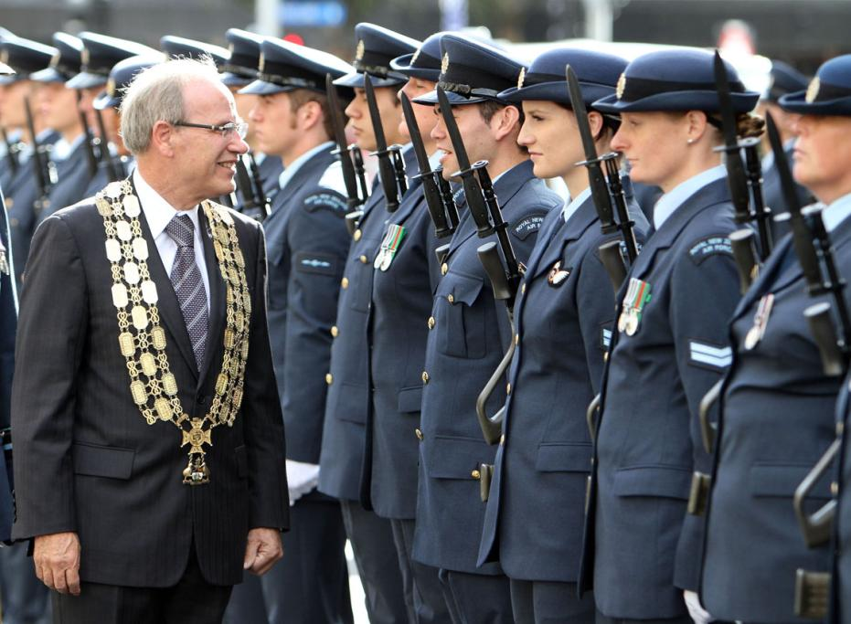 Len Brown inspects a Royal New Zealand Air Force parade held in Auckland during the air force's 75th anniversary.