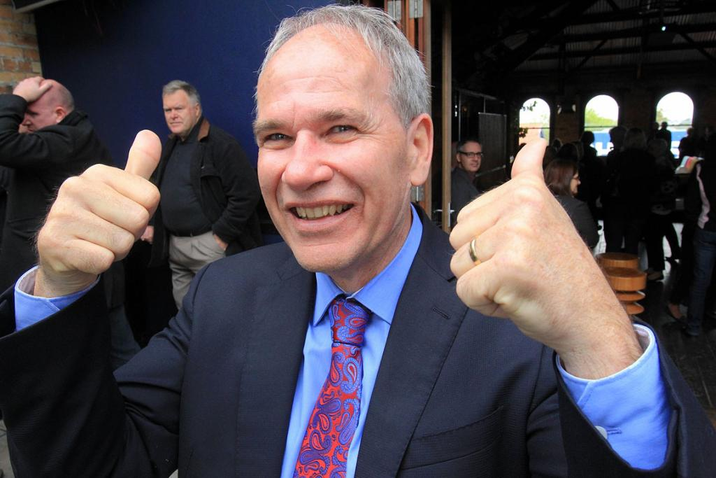 Len Brown celebrates being re-elected Auckland mayor on Saturday.