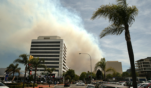 THE FIRE RISES: Bushfire smoke can be seen over the top of Wollongong, New South Wales.