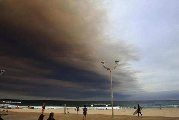 Smoke from bushfires drifts out over Sydney's Bondi beach.