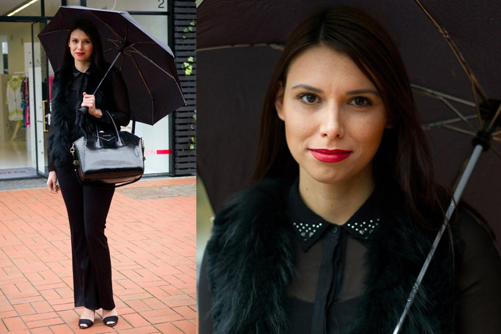 Anastasia, spotted in Britomart, wears a chic black outfit including a stunning Givenchy bag for a rainy spring day