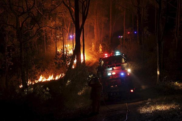 Royal Fire Service (RFS) firefighters work late into the night strengthening containment lines on the State Mine Fire outside of Bilpin.