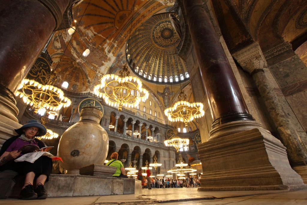A foreign tourist pauses as she visits the Byzantine monument of Hagia Sophia or Ayasofya, now a museum, in Istanbul.