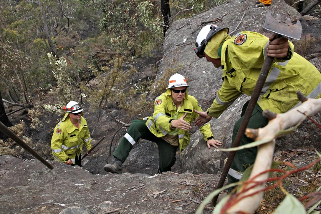 A Remote Area Fire Team work in a remote section of the Bargo River Gorge where they are scraping out a containment line in a critical part of the National Park.