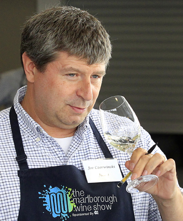 Sniff, swirl, spit: Judge Joe Czerwinski tests the nose of a Marlborough wine during the Marlborough Wine Show