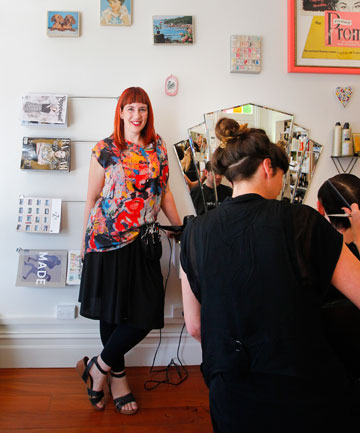 Owner Lisa Ussher in her Cuba St salon The Powder Room